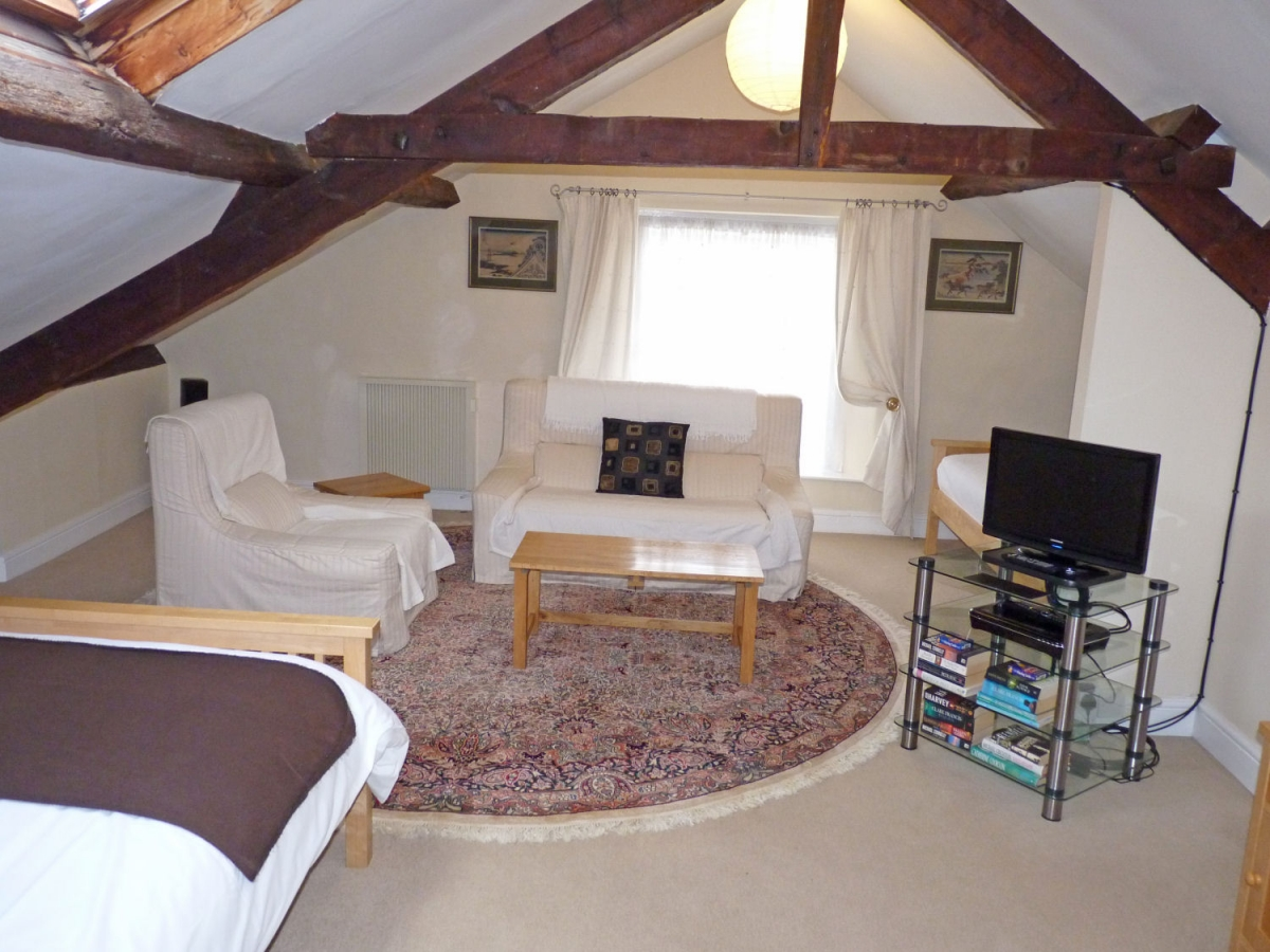 Room 6 includes a double and single bed